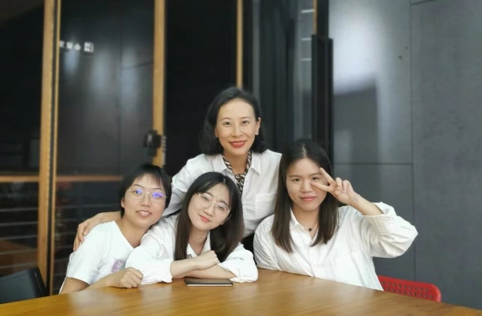 Xia Baojun (back row) with three of her students..jpg