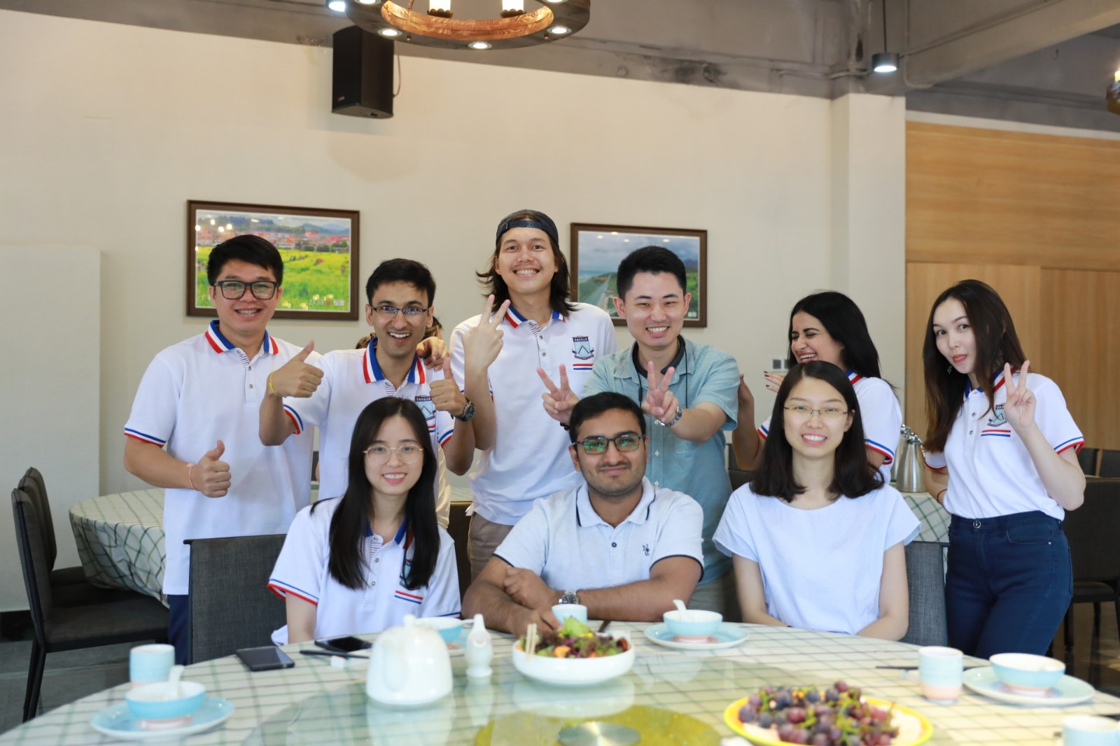 Abbas Zaheer (second left, back row) enjoys his time with his friends in China.jpg